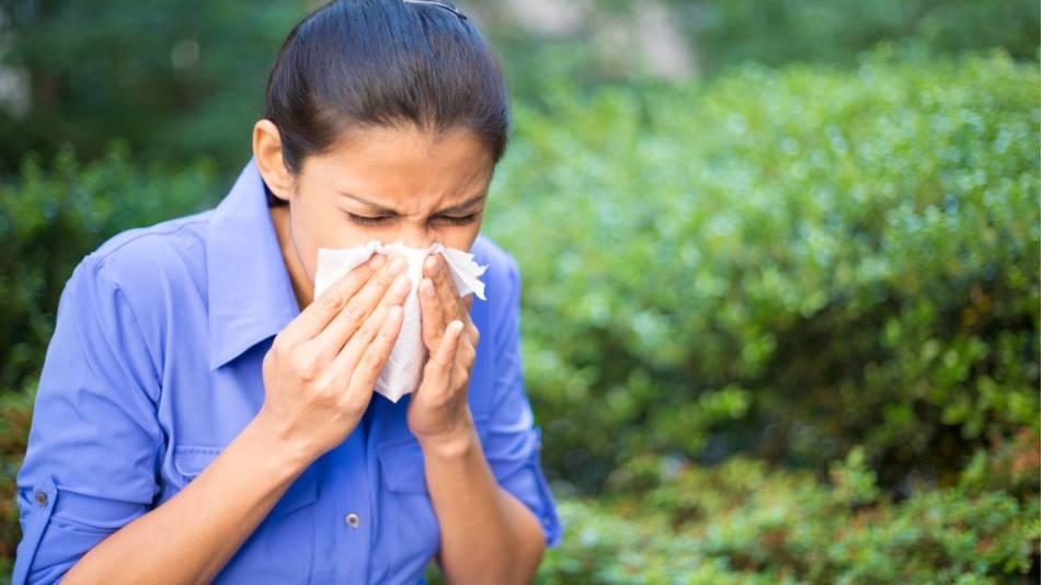 Supplements for Seasonal Allergies -- Woman Outside Sneezing