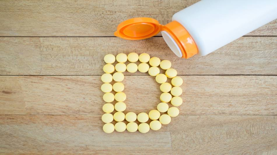 Too Much Vitamin D? -- bottle of vitamin D and vitamin D tablets in the shape of the letter D