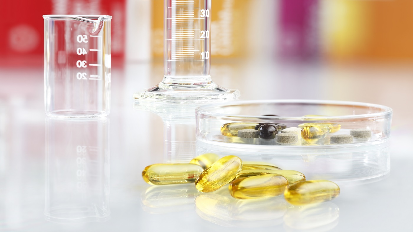 Does the FDA Approve Laboratories That Test Supplements? -- supplement capsules in glassware in laboratory