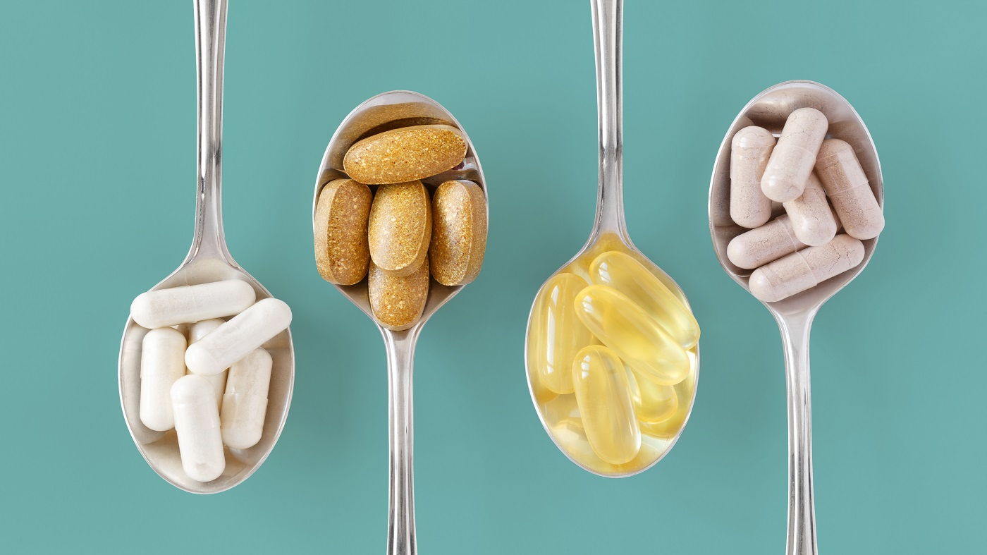 Vitamins & Minerals That Should Be Taken Together or Separately -- various vitamins in spoons