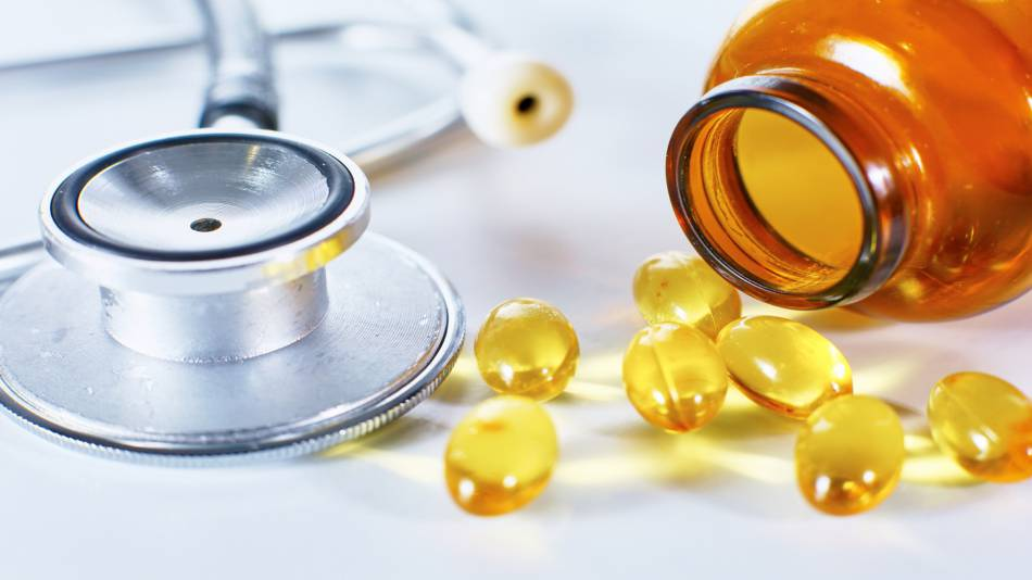 Fish Oil for Heart Health? -- fish oil capsules and stethoscope