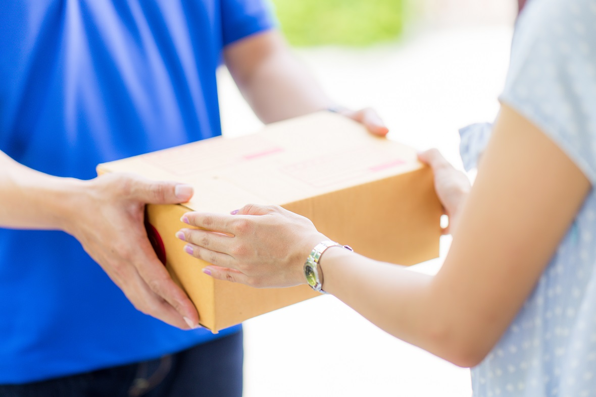 Heat's Effect on Supplements in the Mail -- Woman receiving a package
