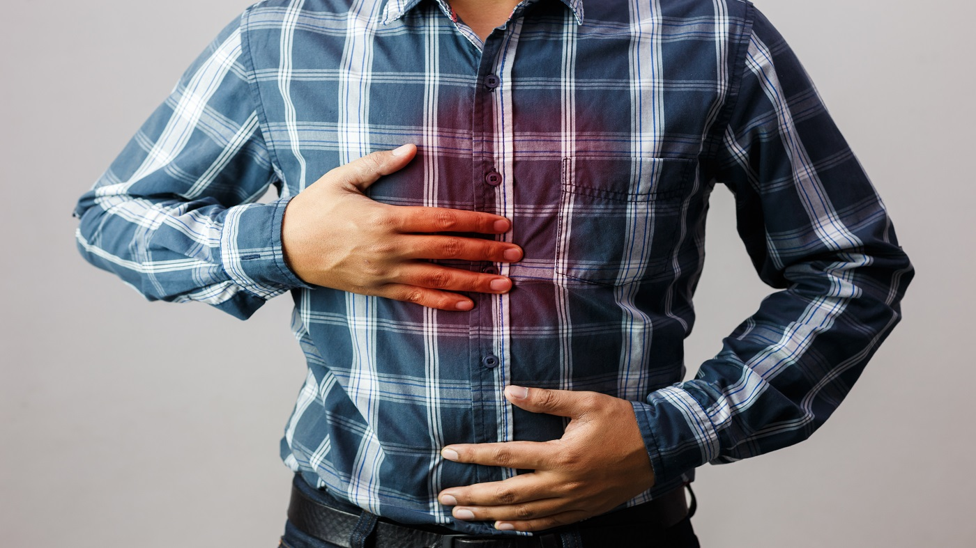 Supplements for Indigestion and Heartburn -- man with heartburn pain