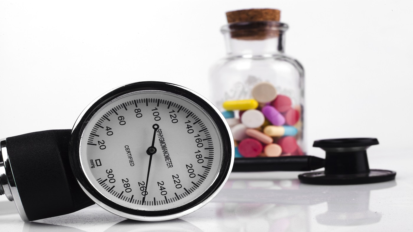 Supplements that can lower, or raise blood pressure -- blood pressure cuff and bottle of pills