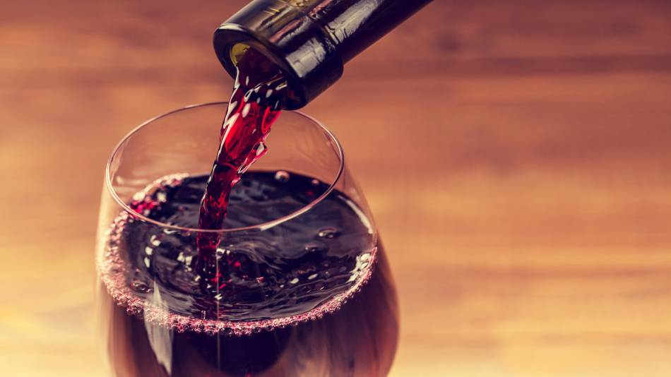 Resveratrol in Red Wine -- red wine pouring from bottle into glass