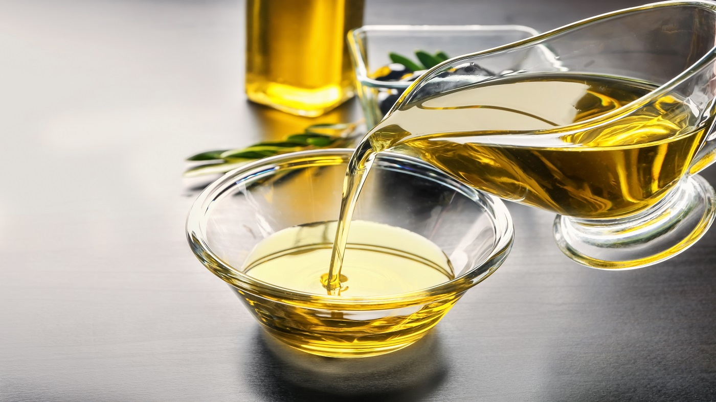 Choosing the Best Quality Olive Oil -- pouring olive oil into a bowl