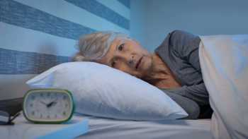 Can Red Yeast Rice Cause Insomnia? -- Woman With Insomnia, Awake In Bed