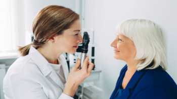 Supplements for Macular Degeneration -- woman getting eye examination
