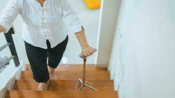 Supplements to Improve Balance & Reduce the Risk of Falls -- older woman walking up stairs