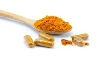 Lead Contamination in Turmeric Spice & Supplements -- Spoonful of turmeric spice and turmeric pills