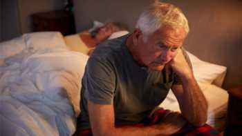 Glycine for Sleep and Nighttime Urinary Frequency? -- Older Man Sitting on Bed, Awake at Night