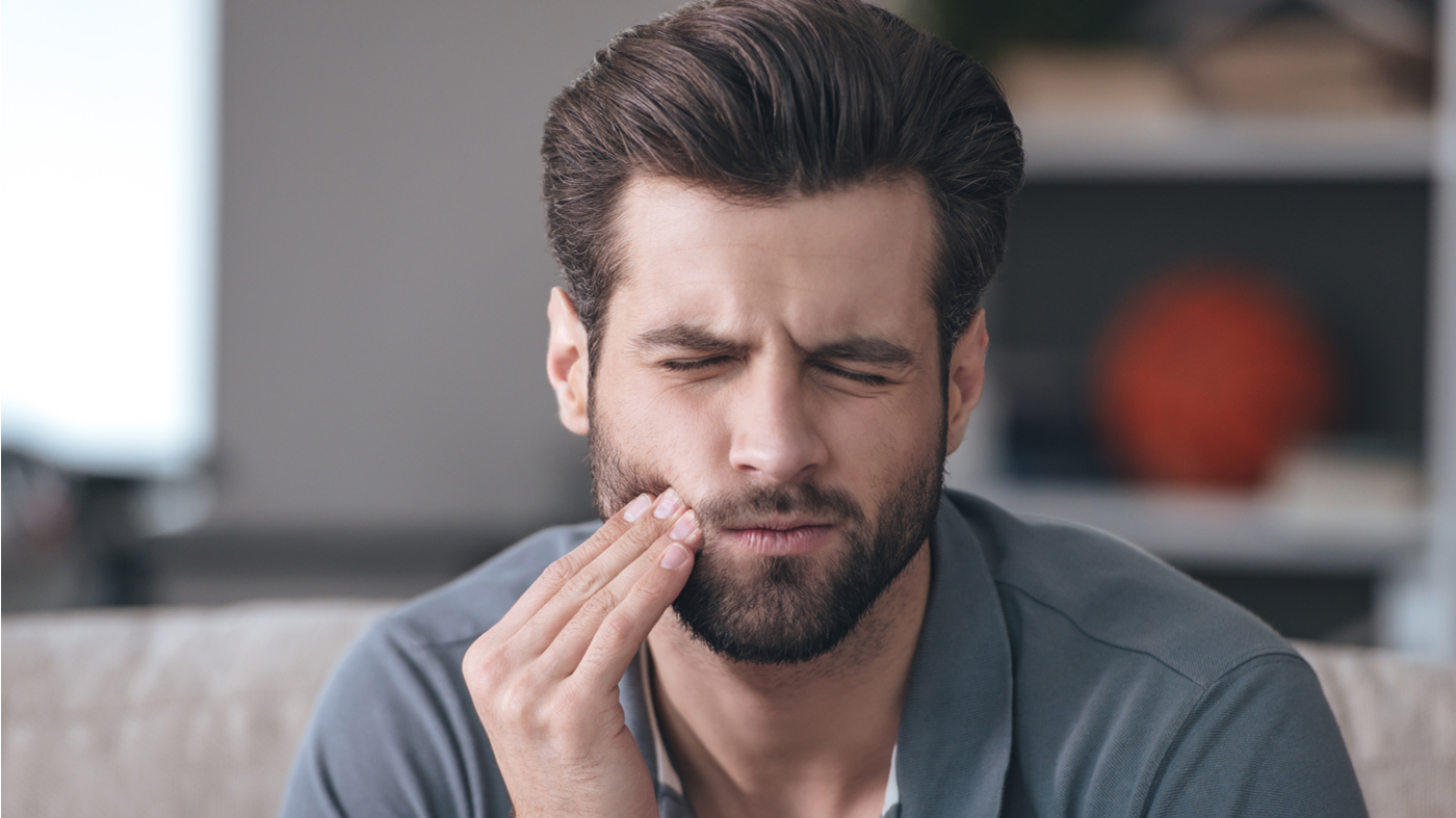 Lysine, Vitamins & Minerals for Canker Sores -- Man with canker sore