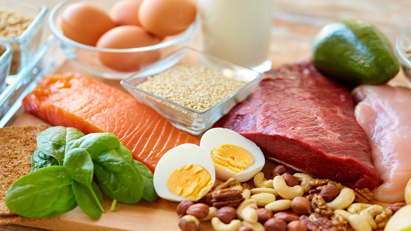 Good Sources of B Vitamins -- selection of healthy foods including eggs, rice, nuts, seeds, salmon, chicken