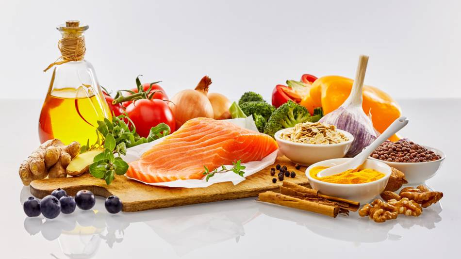 Low-carb & Mediterranean Diets for GERD? -- Table with Mediterranean foods such as fish, olive oil, walnuts, vegetables