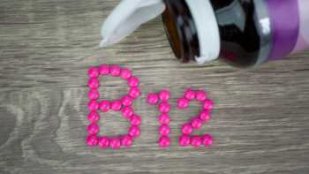 Vitamin B12 Dosage, Benefits, Uses & Deficiency -- B12 Bottle and Tablets