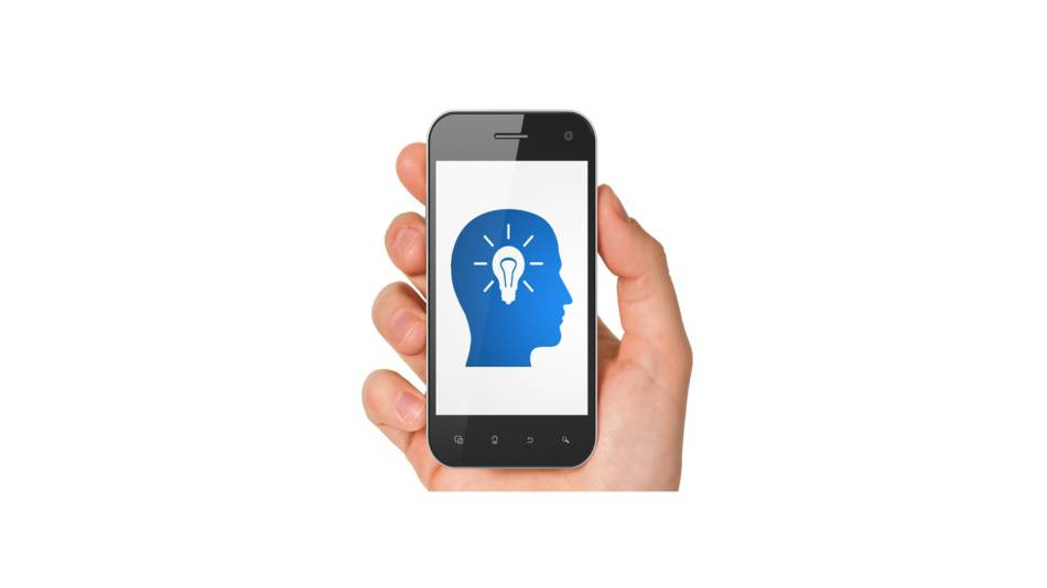Do brain games really improve memory? -- hand holding smartpphone with game app