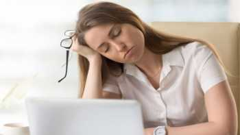 Adrenal Fatigue and Adrenal Support Supplements -- Tired Woman Falling Asleep at Her Desk