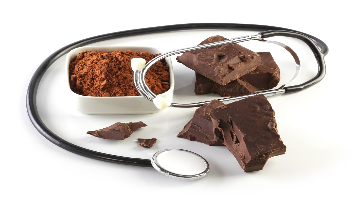 The Benefits of Dark Chocolate -- Dark chocolate, cocoa powder and stethoscope
