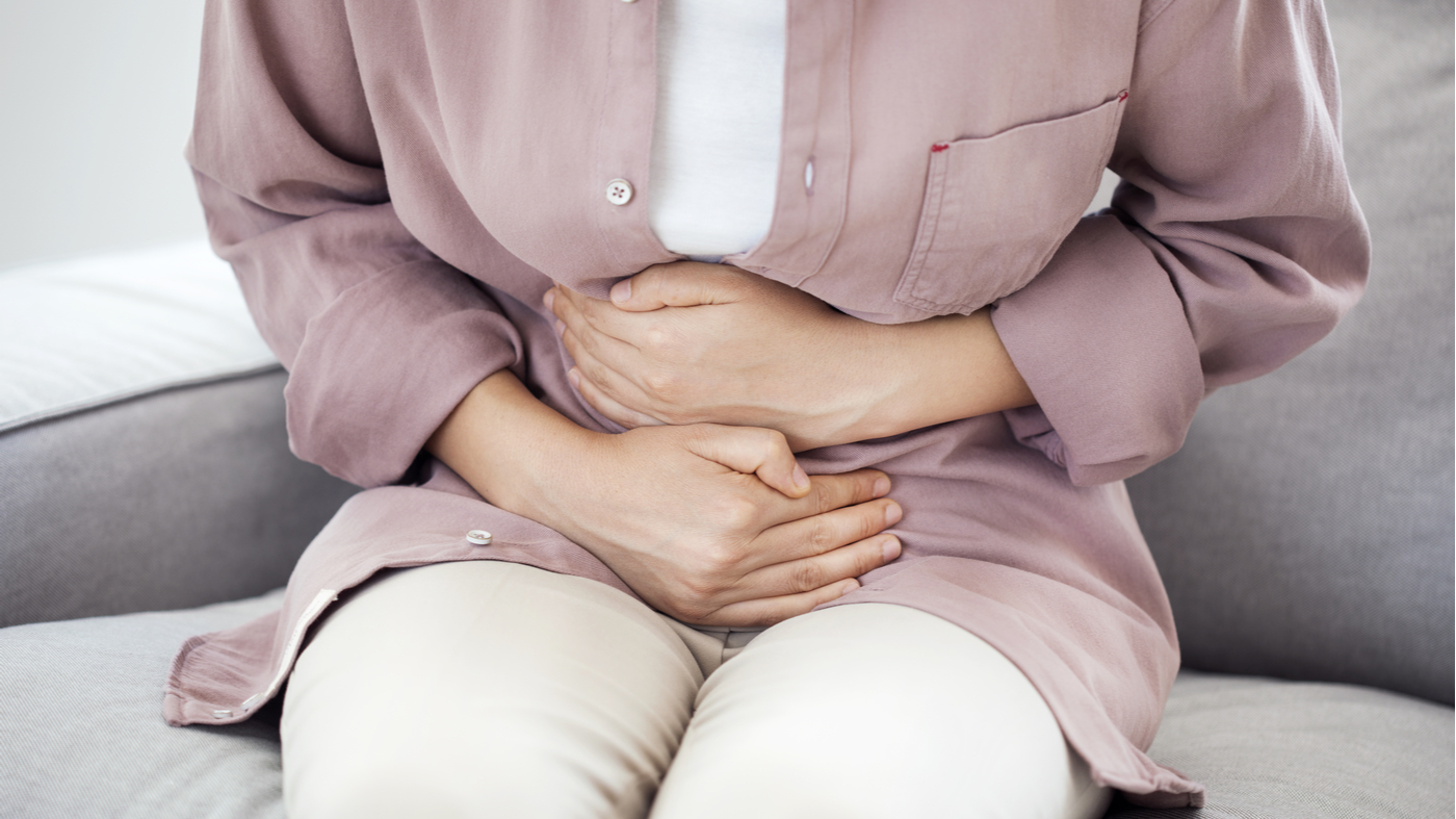 Which supplements can cause constipation? -- Woman with gastrointestinal pain