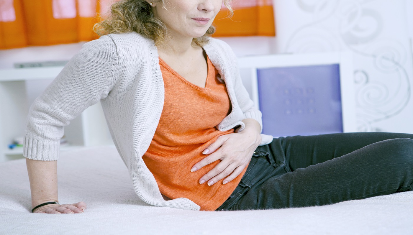 Collagen Supplement Side Effects -- woman with stomach pain