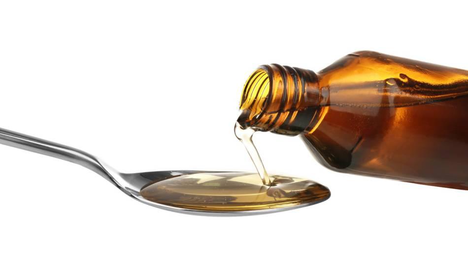 Fish Oil vs. Cod Liver Oil -- bottle of cod liver oil pouring into spoon