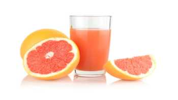 Grapefruit Juice, CYP3A4 and Supplement Interactions -- glass of grapefruit juice and grapefruit halves