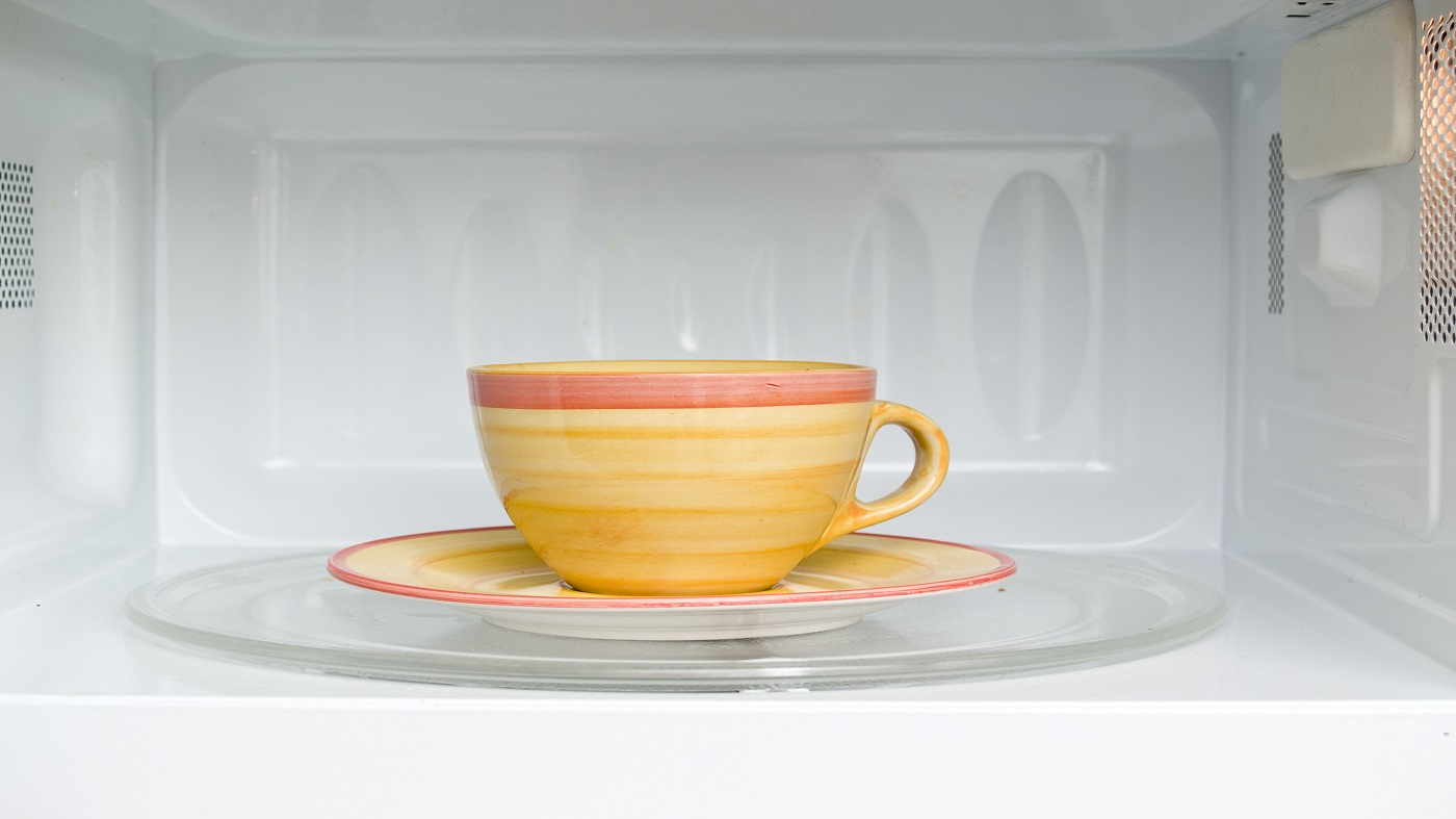 Does Microwaving Green Tea Affect Amounts of EGCG? -- teacup in microwave