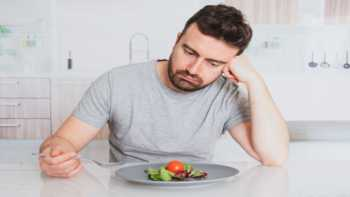 Vitamin Deficiency, Supplements and Loss of Taste? -- man with salad looking disinterested, unhappy