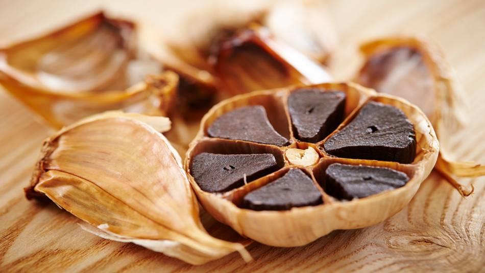 Black Garlic Health Benefits -- black garlic cloves up close