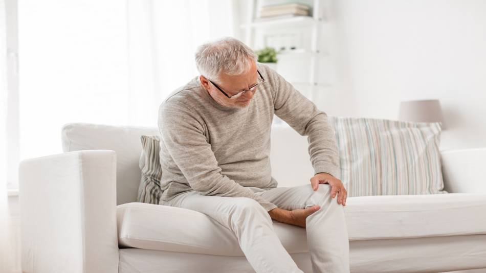 Side Effects of Boswellia -- man holding his knee