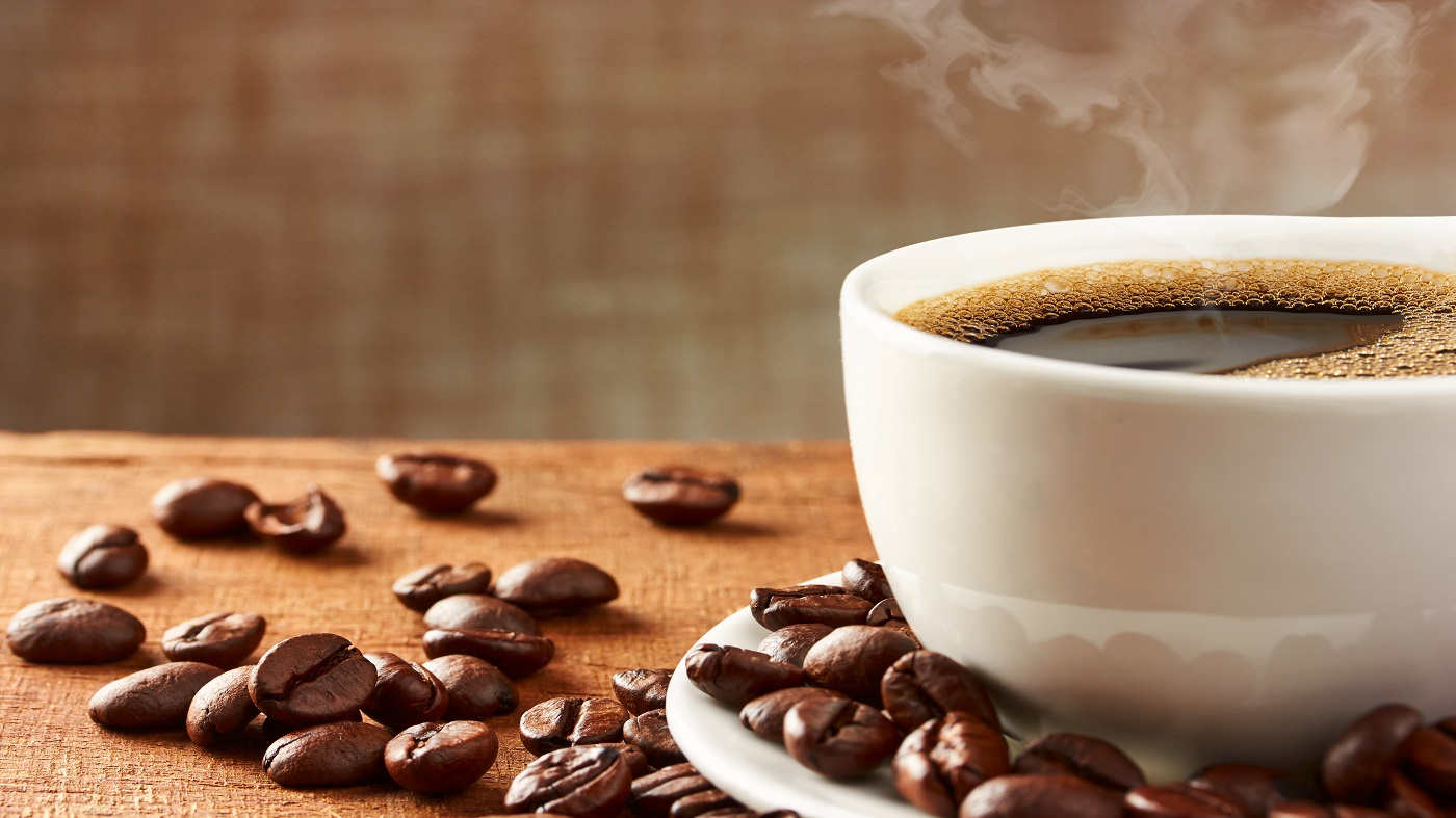 Coffee and Gallstones -- coffee in cup and coffee beans