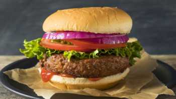 Beyond Burger vs. Impossible Burger: Nutrition, Vitamins & Minerals -- cooked plant-based burger on bun
