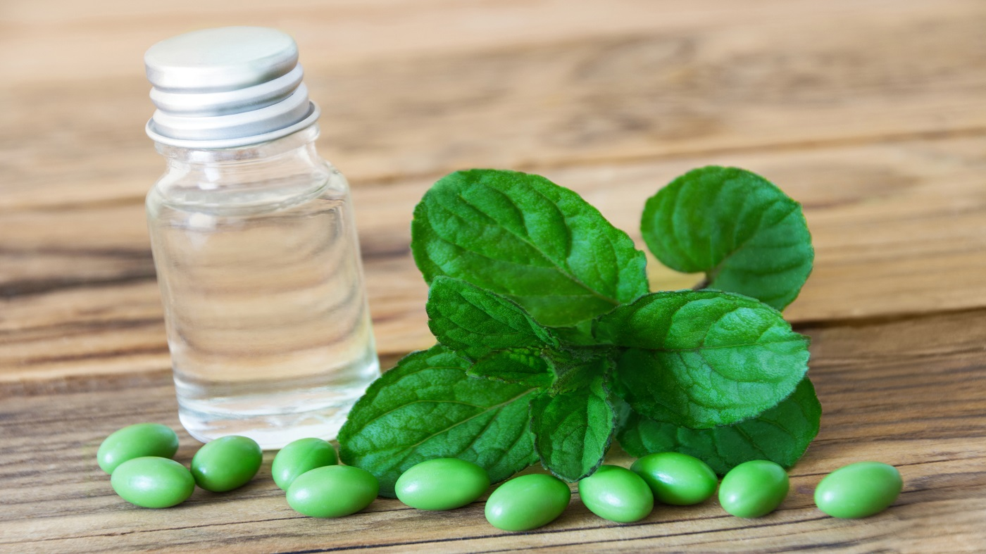 Peppermint Oil for IBS? -- Bottle of peppermint oil and capsules and peppermint leaf
