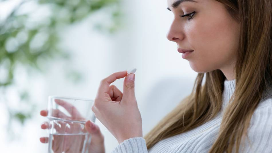 Lead in Supplements & Foods -- concerned woman looking at pill