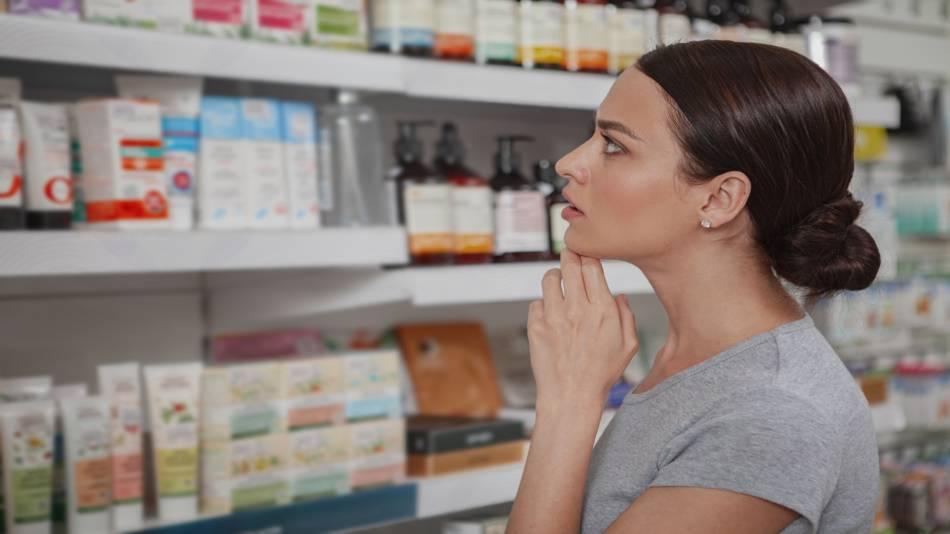 Vegetarian/Vegan Collagen Supplements -- woman shopping for vegan supplements