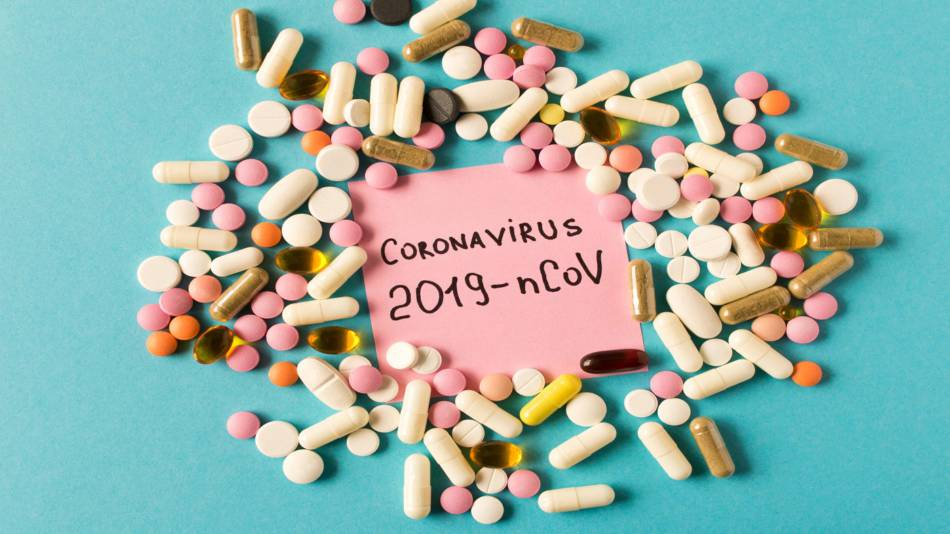 Coronavirus Risk With Supplements from China? -- 'Coronavirus' written on paper surrounded by supplements capsules and tablets