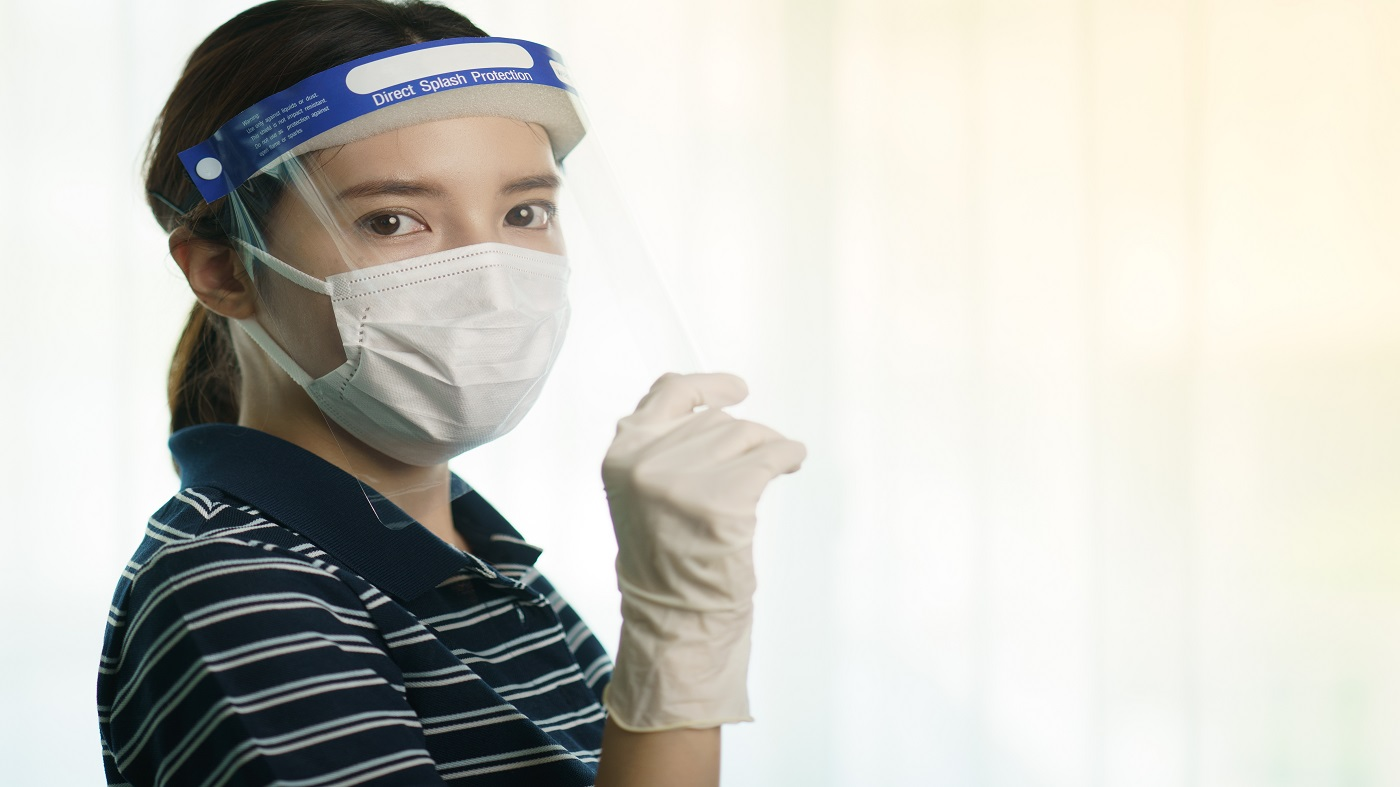 Face Shield to Protect From Coronovirus (COVID-19) -- Woman Wearing Face Shield, Mask and Gloves