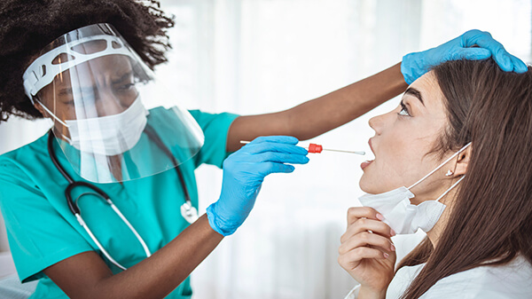 Best COVID Tests, Accuracy, Where to Find & More -- Boy Getting COVID Test