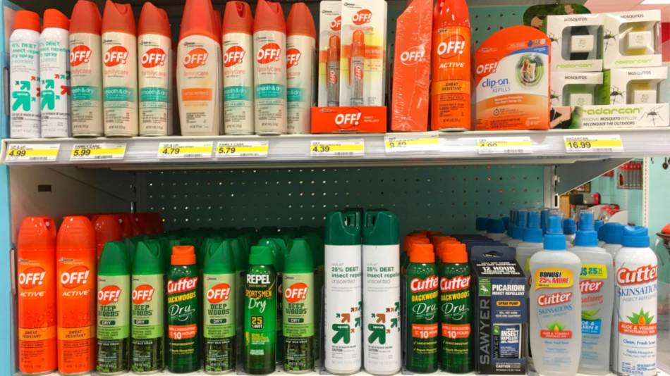 Is Permethrin Safe to Spray on Clothes? -- tick on aerosol bottle