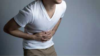 Supplements for peptic ulcer disease - young man with stomachache