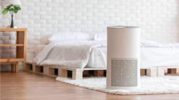 HEPA air purifier on bedroom floor