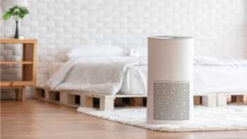HEPA air purifier on bedroom floor
