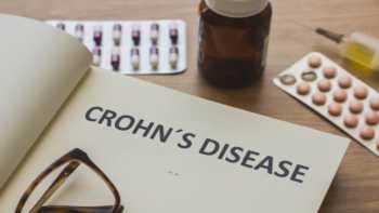 Supplements for Crohn's Disease -- Crohn's Disease Written on Notepad, Pills