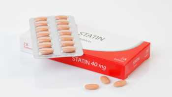 Statin Interactions With Supplements -- close-up of statin medication box and tablets