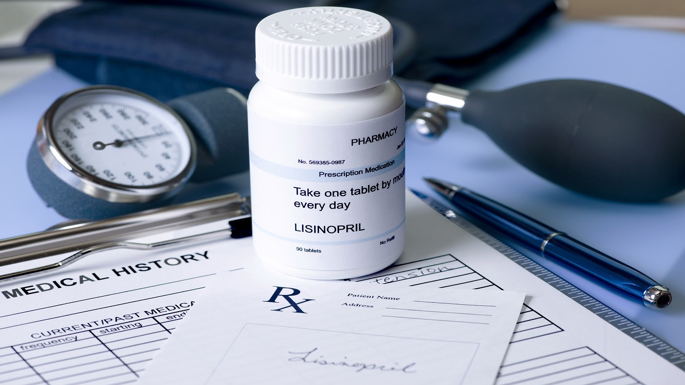 Lisinopril, ACE Inhibitors and Supplement Interactions -- prescription bottle of lisinopril on desk with blood pressure cuff