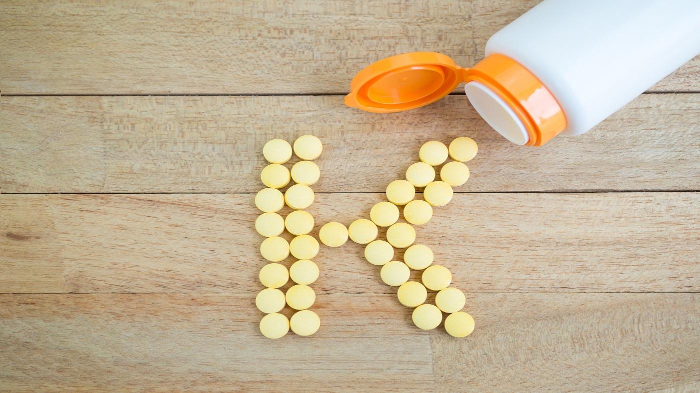 Vitamin K: MK-4 vs MK-7 -- vitamin K tablets in the shape of the letter 'K'